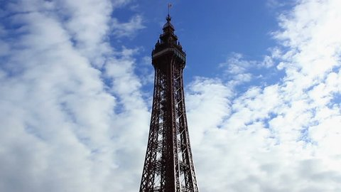 Skyline of the Blackpool Tower - time lapse. It is a tourist attraction in Blackpool, Lancashire, England, which was opened to the public on 14 May 1894.