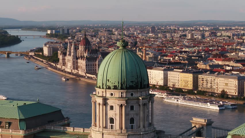 Aerial video shows the Buda Castle and the river Danube in Budapest sunset - drone video
