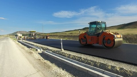 Skopje, Macedonia - 31 Jul, 2017: Road construction. Road roller doing repair and paving of streets, Building s New Road with Road Repair