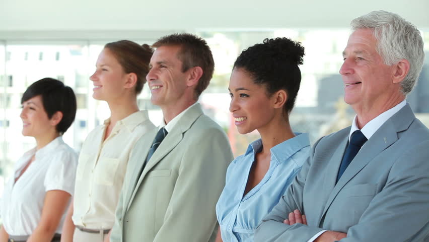 Business people in line looking away in a bright office | Shutterstock HD Video #3008692