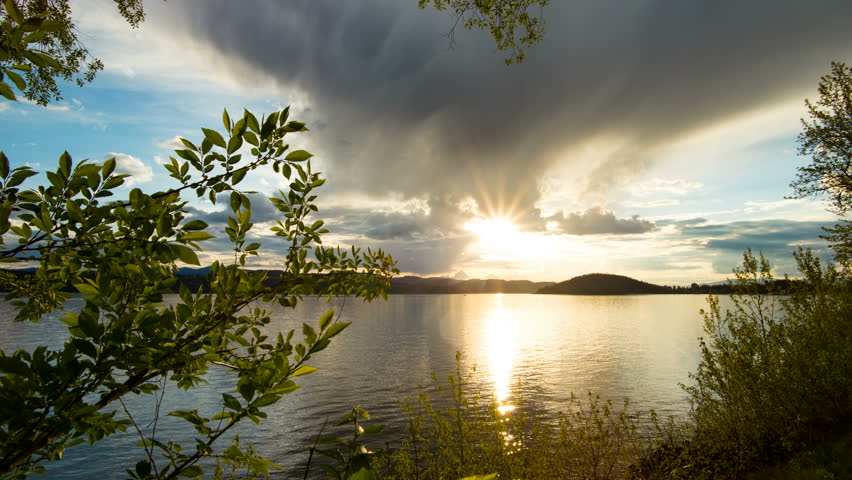 Time lapse of colorful sunset moving on slider at lake Coeur d'Alene