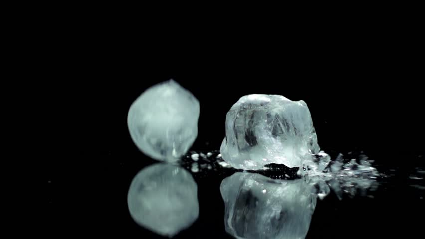 Ice cube breaking splashing cold fresh drink and food