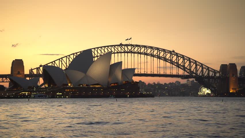Panoramic view of Sydney Opera house and Harbour bridge at sunset - April 2017: Sydney, Australia