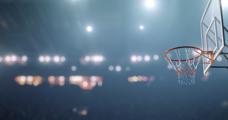 Basketball player makes a slam dunk during a game. He wears unbranded sport clothes.
