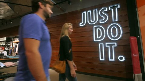 BERLIN, GERMANY - CIRCA JULY, 2017: JUST DO IT sign inside Nike shop. Nike is one of the world's largest suppliers of athletic shoes and apparel. The company was founded on January 25, 1964.