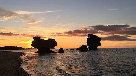 Silhouette of mountain shape heart rock in ocean at Okinawa,Japan.