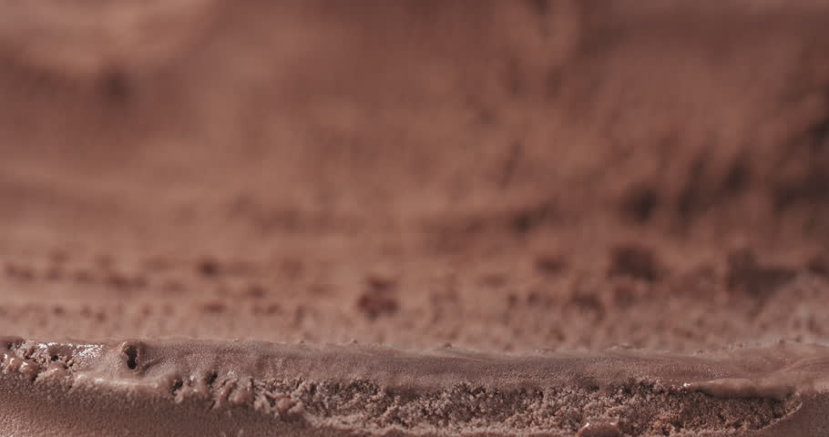 Slow motion of scooping chocolate ice cream with spoon