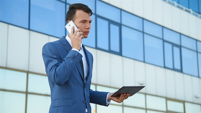 Angry businessman looks at statistics in tablet and yells at employees on the phone | Shutterstock HD Video #30189112