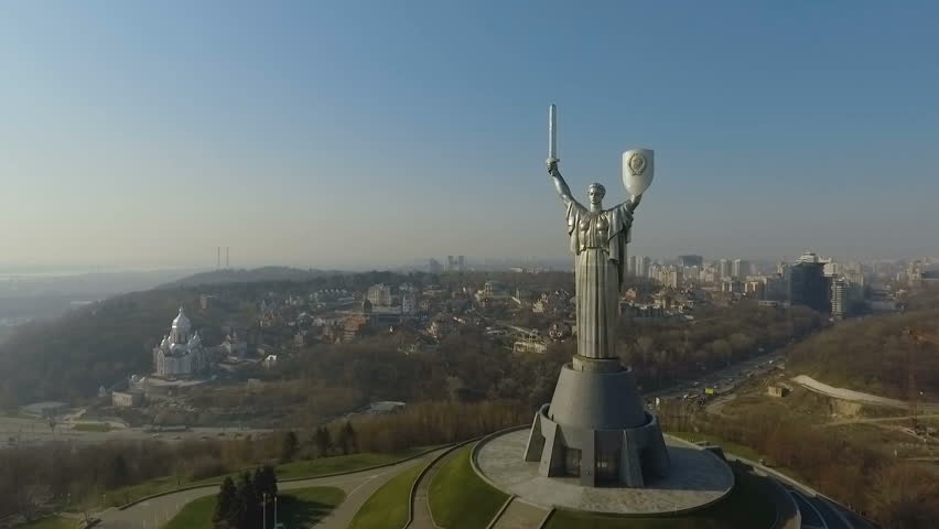 KIEV, UKRAINE March 29, 2017: Aerial view. Monument of World War II. City aerial view.The camera flies around the 102 meter monument.