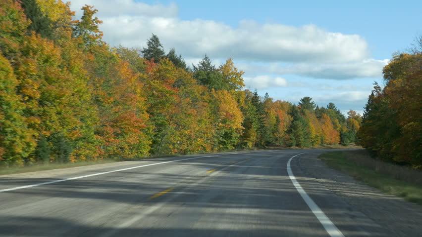 Driving POV in Autumn on M-77 (Michigan state route 77) in  Alger County, Upper Peninsula, Michigan.