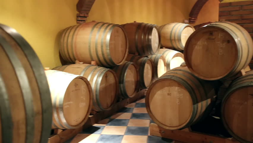 oak wine barrels. porrera spain september 21 2016 interior of wine cellar with many wooden oak barrels