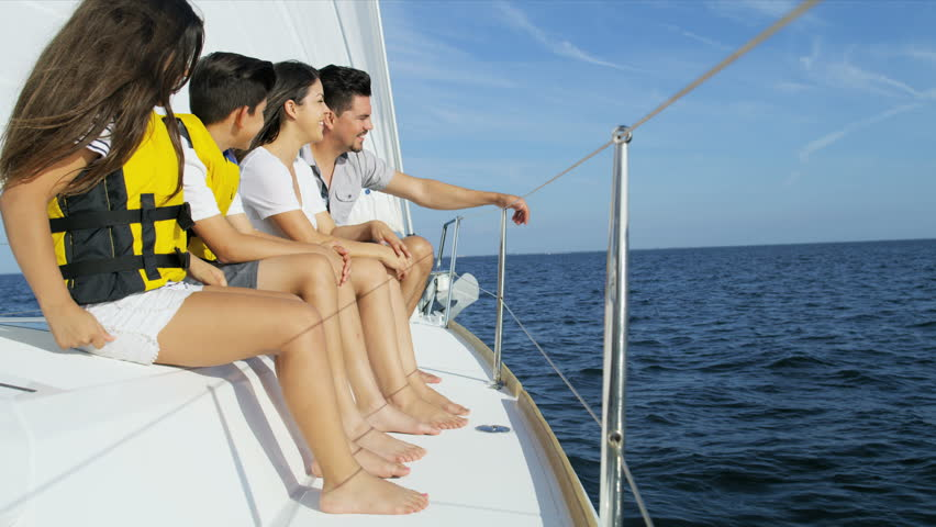 Young ethnic Latino family enjoying carefree lifestyle sailing the ocean on luxury yacht in the Summer sun RED WEAPON | Shutterstock HD Video #30250282