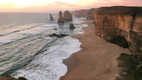 4k cinematic b-roll footage of rock formation along the coastline, The Twelve Apostles at Great Ocean Road, Australia during beautiful sunset.