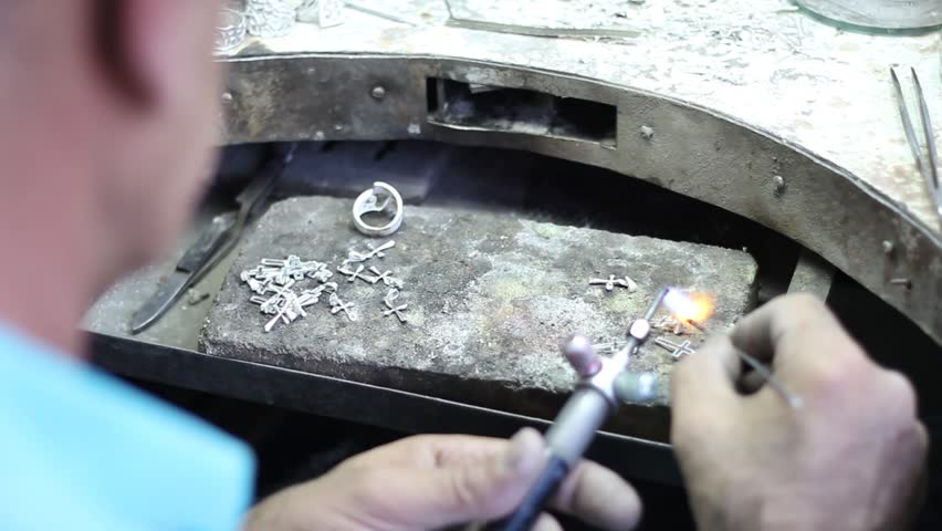 Manufacture of carved articles from silver by hands, handwork on silver in Armenia, decoration of manual production of silverware. Armenian silver production, man worked in silver manufacture. FHD.
