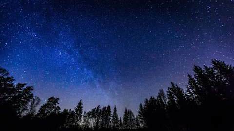 Starry night sky with Milky Way and meteors. 4k time lapse