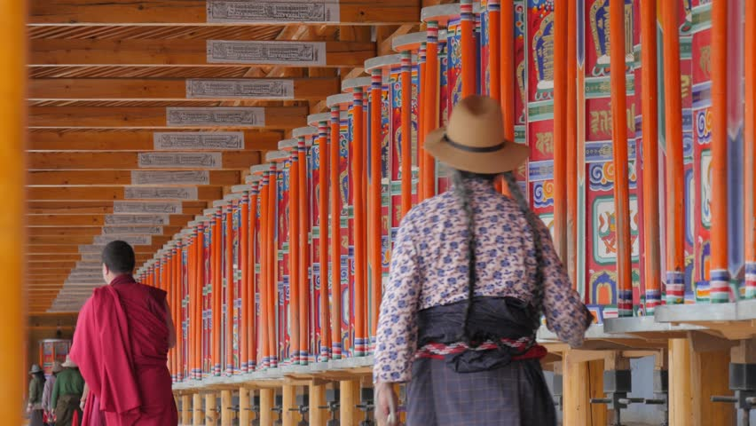 Xiahe,Gansu,China - June 11,2017: People spinning prayer wheels around monastary | Shutterstock HD Video #30291952
