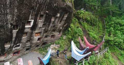 aerial view slider shot traditional grave , South Sulawesi Indonesia