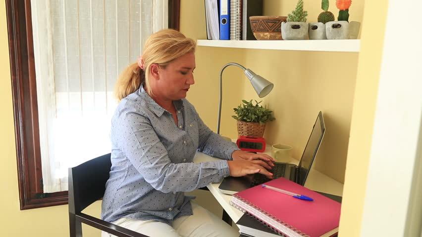 Tired businesswoman having nack pain