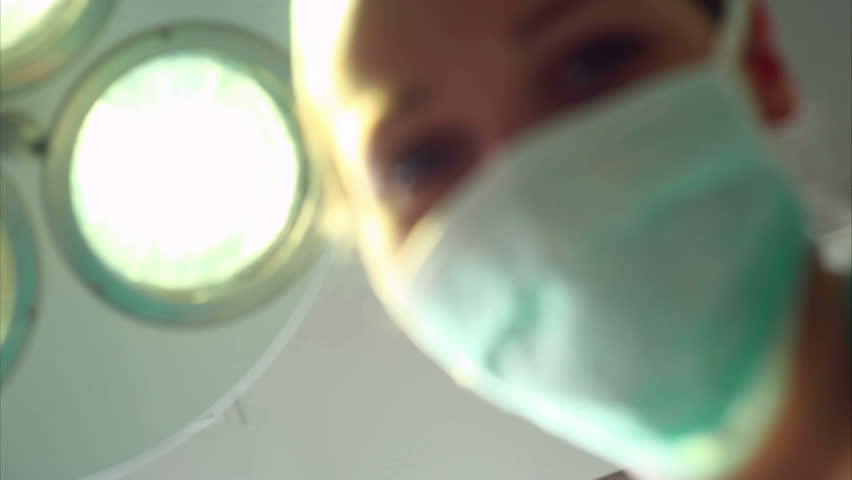 Video of a nurse looking at a patient waking up in an operating theatre
