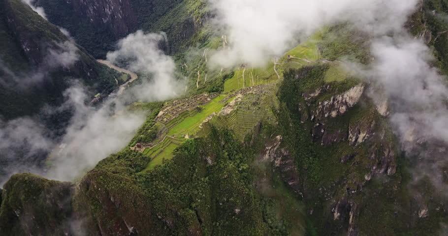 Machu Picchu Peru Aerial v3 Birdseye view flying over ancient ruins panning