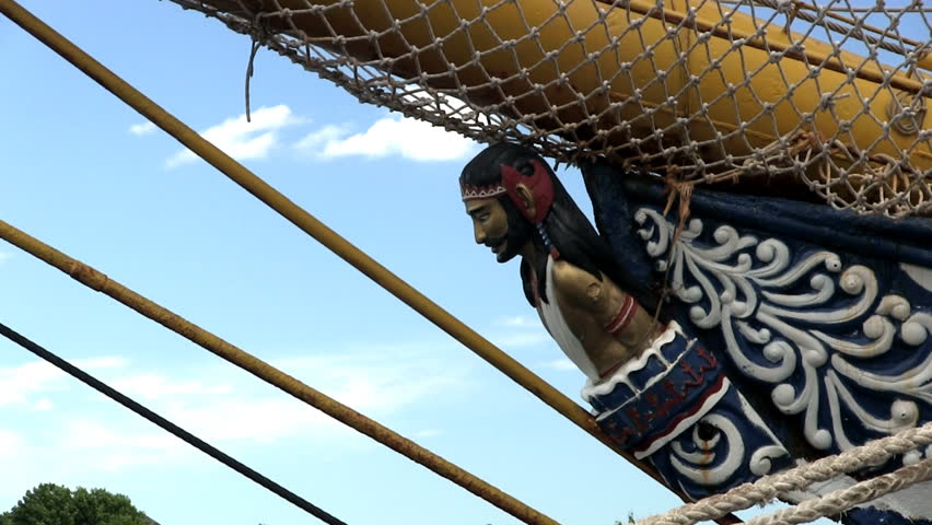 Side profile of figurehead of the mythological Indonesian god of truth and courage on tall ship Dewaruci against blue sky background