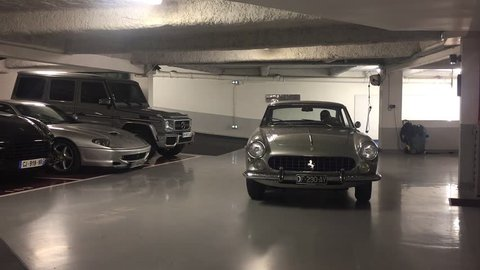Ferrari 250 GTE super car parking in luxury garage for VIP persons. men driving grey vintage ferrari, exclusive ferrari to garage. sport car ferrari gte 250. 02 September 2017, France, Paris. FULL HD.