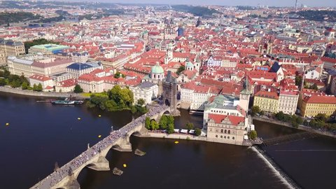 Aerial footage of Prague, Czech Republic, on a beautiful summer's day over Charles Bridge and Prague one municipal district.