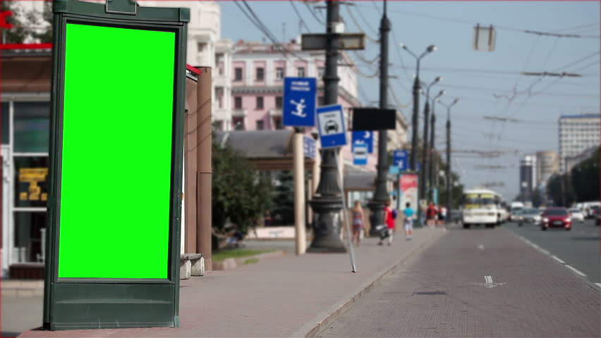Billboard near a road in a city with a green screen. | Shutterstock HD Video #30384892