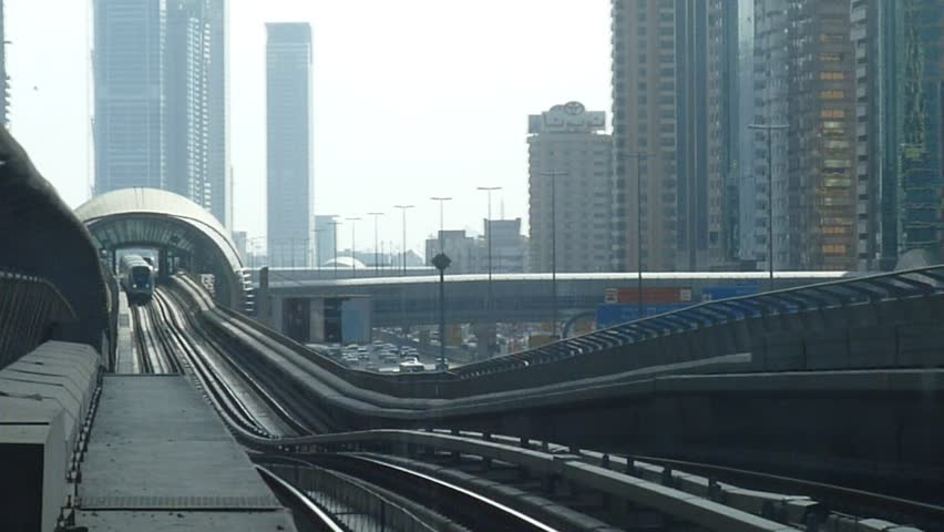 The Dubai Metro arriving at a platform, it is the world's longest driver less, fully automated metro network in the United Arab Emirates city of Dubai. | Shutterstock HD Video #3039490