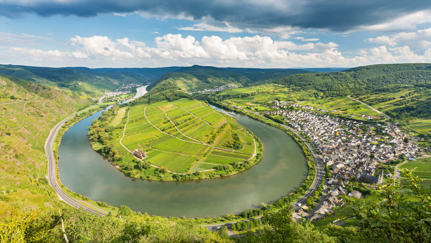 Timelapse sequence of a meander or riverbend of the Moselle River in the Eifel village of Bremm in Germany in summer. Seen from the Calmont vineyards in 4K resoultion. | Shutterstock HD Video #30408172