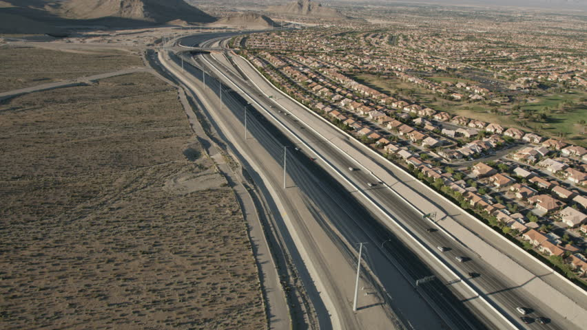 Aerial suburban view of rural residential suburbs vehicle commuter Highway Las Vegas Mojave Desert Nevada USA RED WEAPON | Shutterstock HD Video #30459292