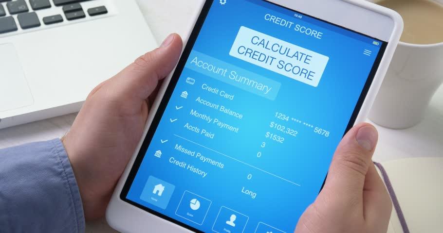 Checking excellent credit score on digital tablet