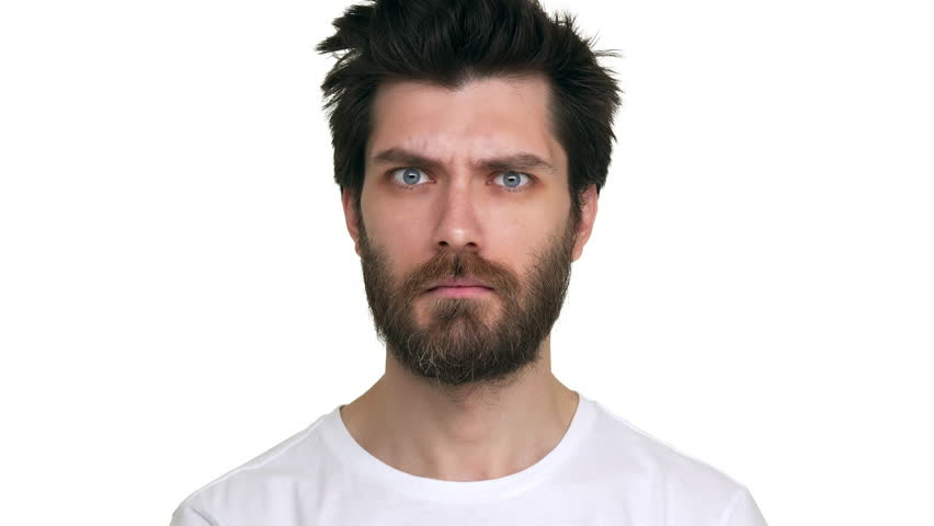 Bearded man moving eyebrows looking confident playful