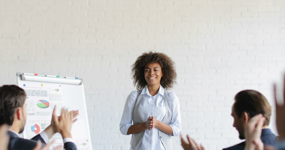 Group Of Business People Applauding Congradulating Happy African American Businesswoman With Successful Speech During Conference Meeting Slow Motion 60