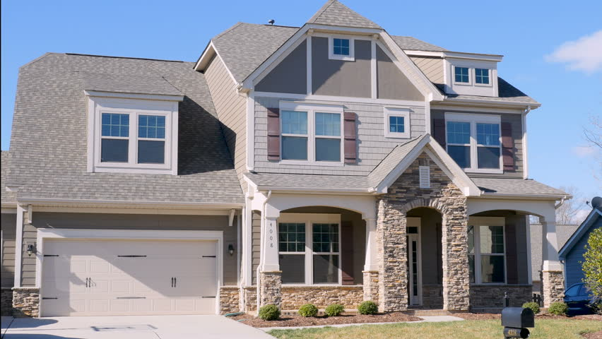 Wide establishing shot of a typical middle class home in a suburban  subdivision where all the