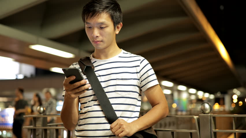 Man sms texting using app on smart phone at night