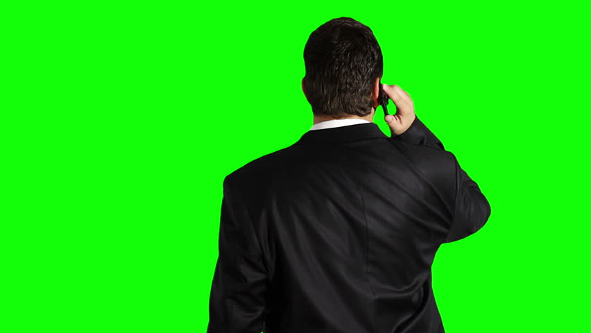 Young Businessman Cell Phone Looking Up Greenscreen  Footage shot against green screen and keyed out. Bg is clean green, removing the it is 1 click. Green spills are removed. | Shutterstock HD Video #3056650