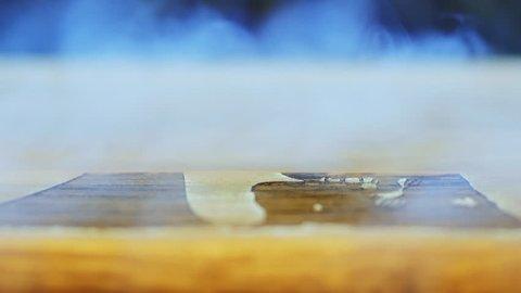 Laser engraving machining working. Laser engraving machining at work. Beam of laser writing picture on plywood