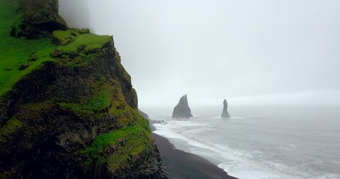 Aerial view of black sand beach and troll toes rocks in the sea.The reynisfjara Black Sand Beach or black sand beaches of Iceland. Which was rated as the most beautiful black sand beach in the world