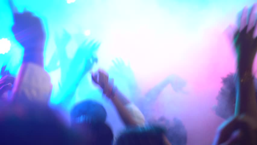 A crowd is seen gathered in front of some funky lights and loud music, dancing and mainly celebrating the last day of Ganesh Chaturthi in Kandivali, Mumbai, India. Shot on September 5th, 2017. | Shutterstock HD Video #30591421