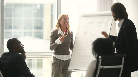 Businesswoman and businessman giving presentation using flipchart, business coaches teaching african black sales managers on staff training, female team leader explaining new company strategy