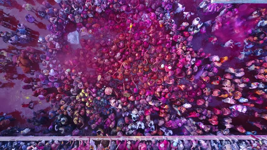 Color battle at the holi festival in India, 4k aerial shot