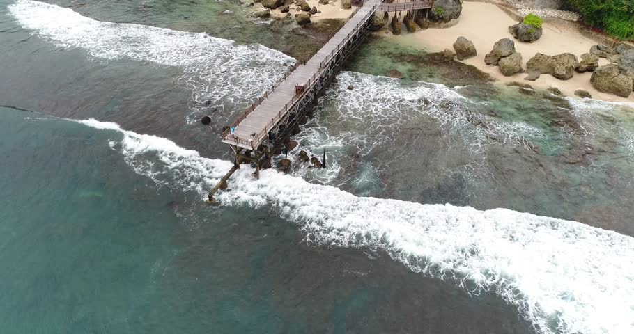 Aerial view bridge in the middle of beach , Bali, Indonesia  | Shutterstock HD Video #30611182