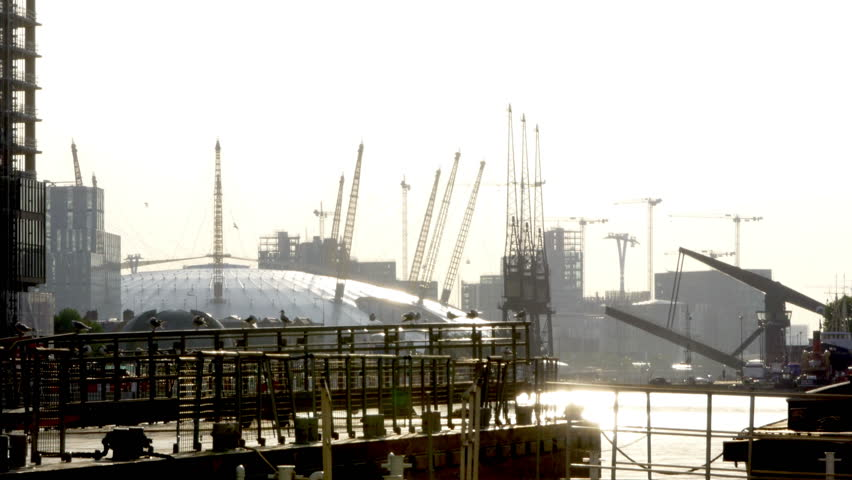 Early Morning with Millennium Dome, Birds and a Closing Weir, Docklands, London, UK