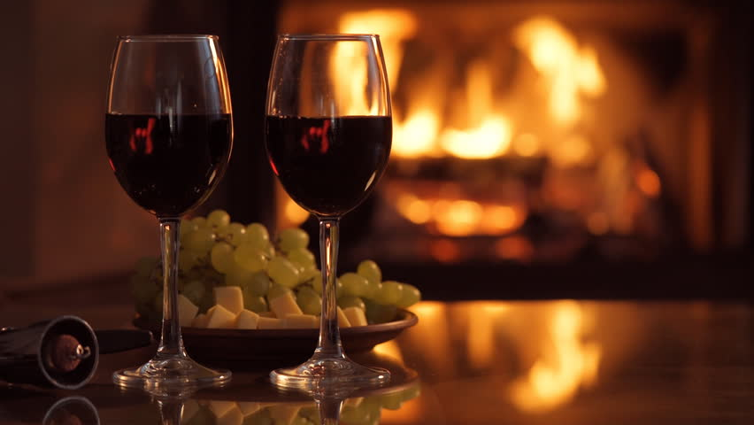 Two Glasses Of Wine On Black Background And Burning