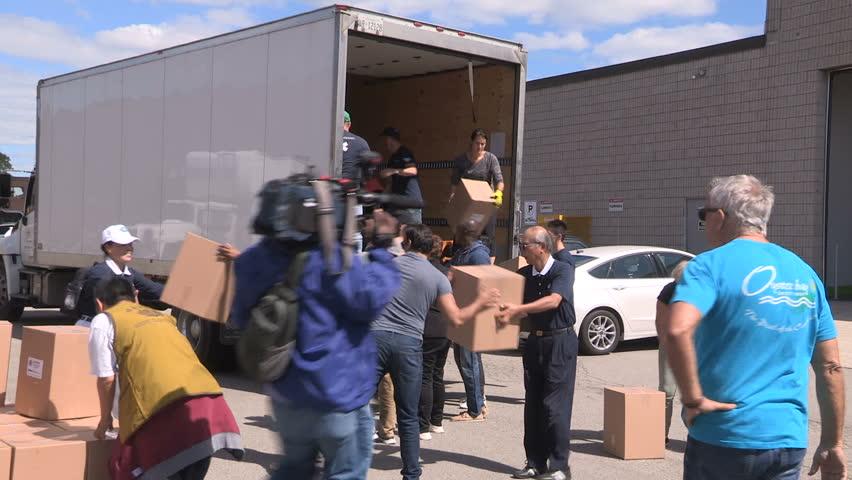 Toronto, Ontario, Canada September 2017 Workers in Toronto prepare emergency aid supplies for hurricane Irma survivors