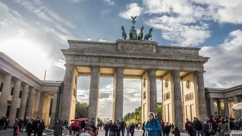BERLIN - CIRCA OCTOBER 2012: Time lapse of people walking past the Brandenburg Gate circa October 2012 in Berlin, Germany.
