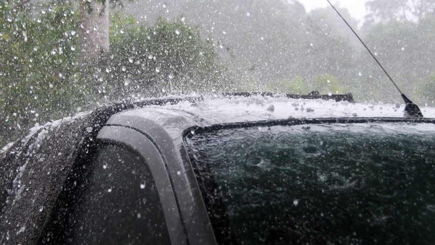 Heavy rain and hail falling on roof of car during violent storm | Shutterstock HD Video #30658222
