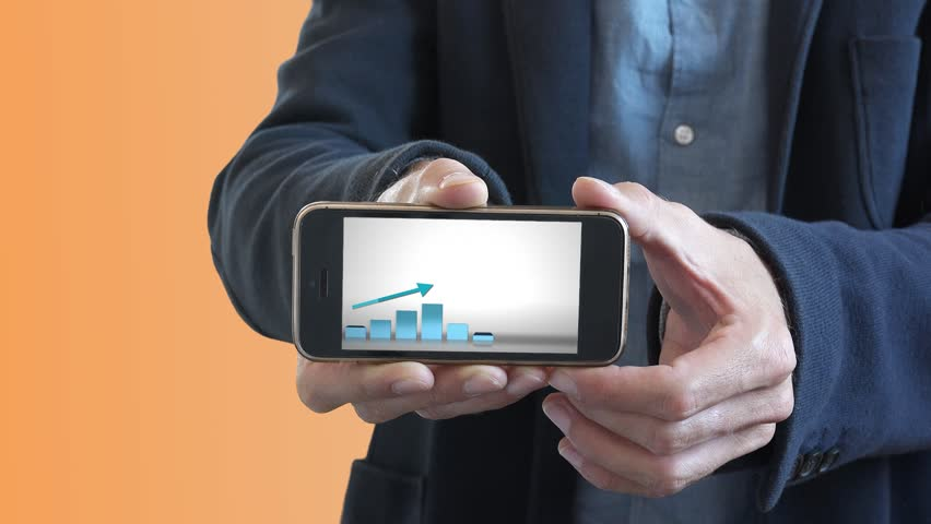 Businessman Presents Positive Chart On Smartphone. Man holding a smartphone with a positive chart in a business presentation | Shutterstock HD Video #30685372