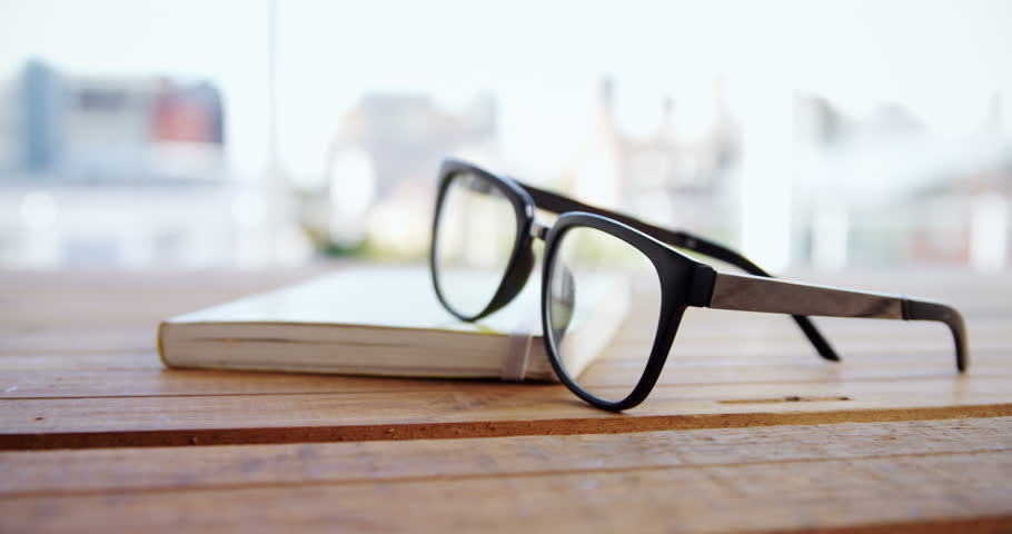 Close-up of spectacles on book at desk 4k | Shutterstock HD Video #30693562